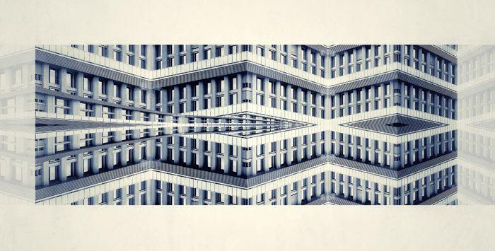 Edificio azulado simetria con formas geometricas arquiectura
