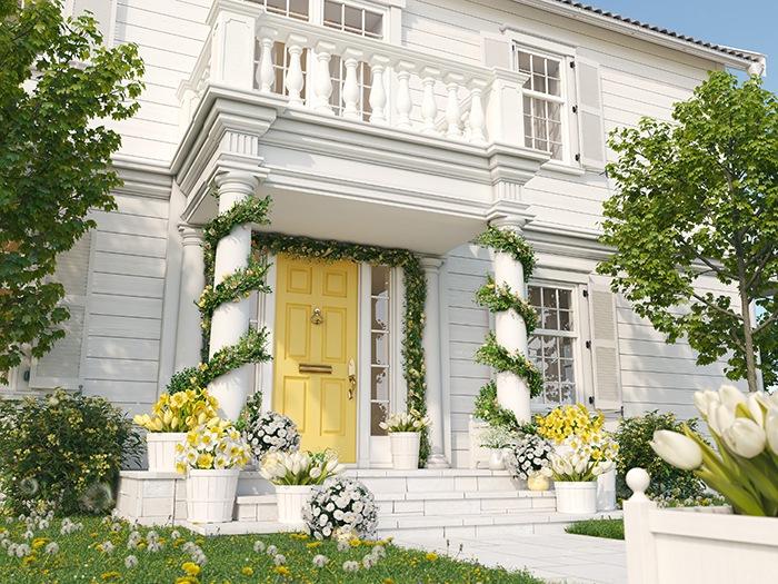 Zona exterior casa blanca con decoración verde