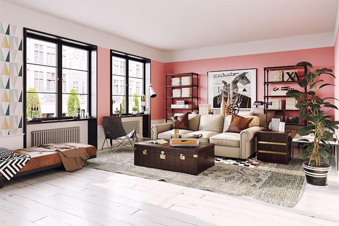 Gran salón con paredes con pintura sectorizada blanca y rosa y motivos geométricos