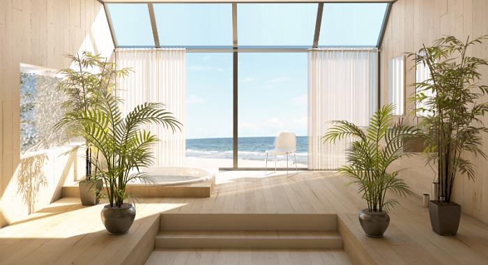 salón de una casa frente el mar