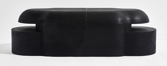 Figura en madera negra para Discovered