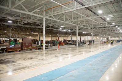 Workers converting the Mack 1 engine plant into a general assembly area for the new Mack Avenue Assembly Plant (FCA