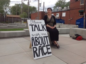 "Jennifer in a St. Louis pocket park with the ""Please Talk With Me About Race"" sign."