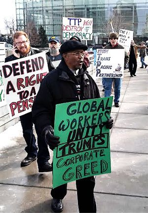 Autoworkers protest outside of the North American International Auto Show