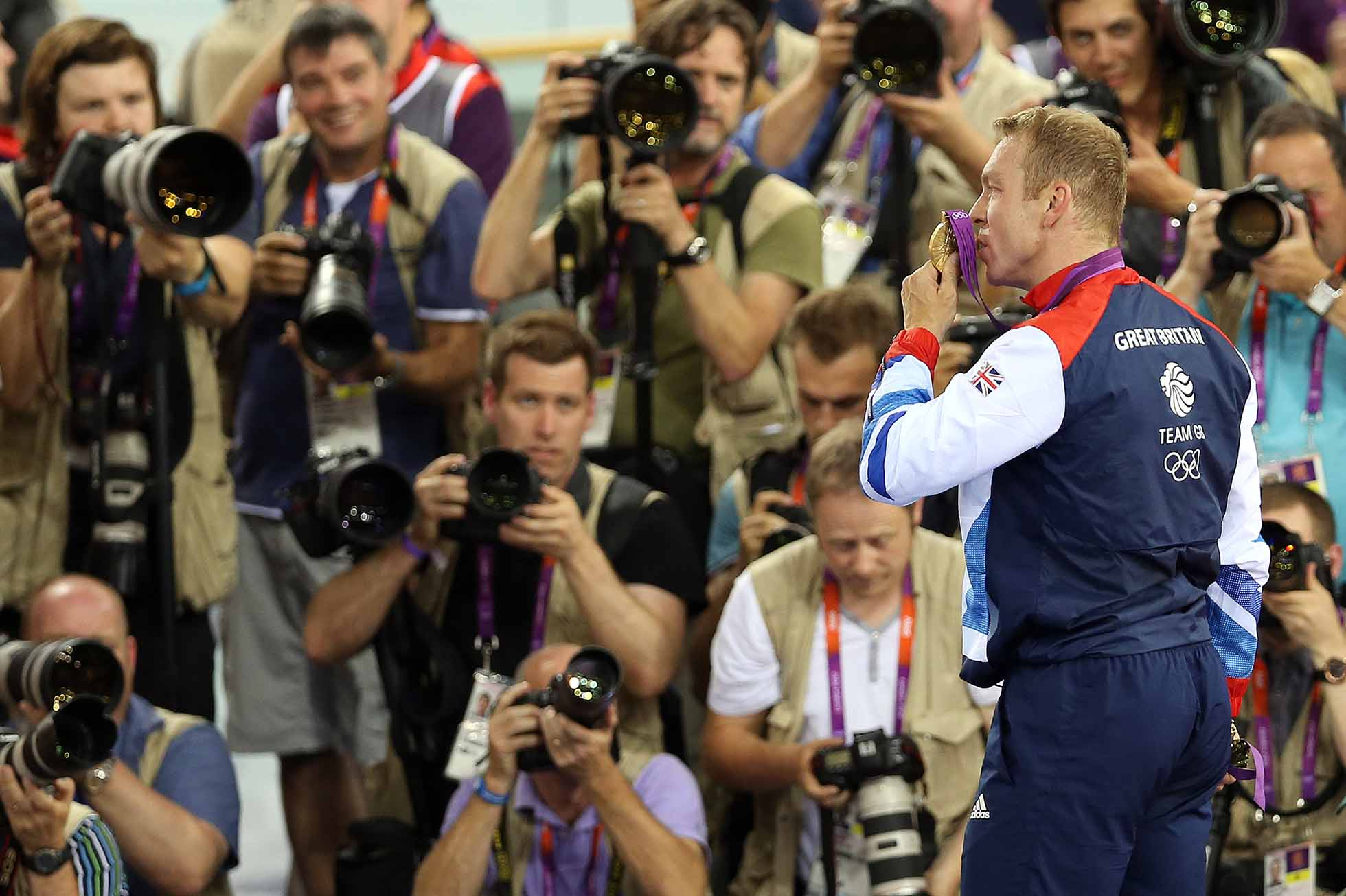 LONDON, ENGLAND - AUGUST 07: Sir Chris Hoy of Great Britain kisses the gold medal he won in final of the men's Keirin during Day 11 of the London 2012 London Olympics at the Veledrome on August 07, 2012 in London, England. (Photo by Ian MacNicol/Getty Images)