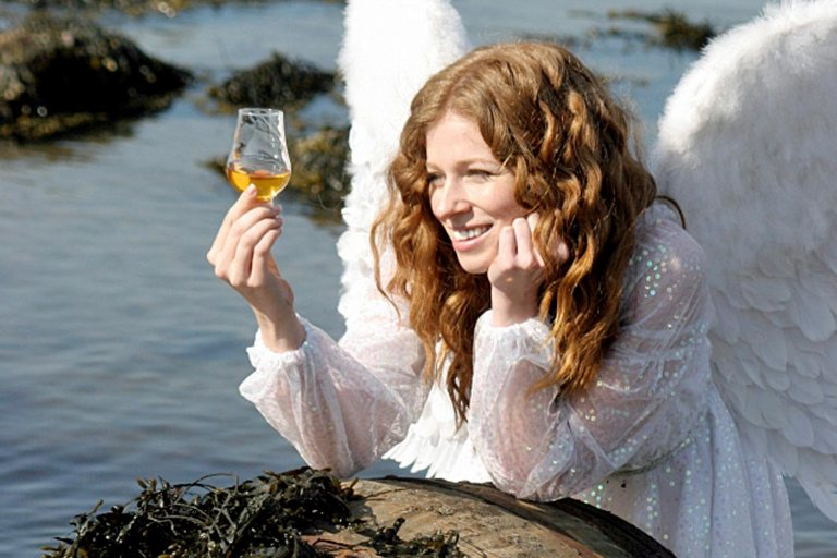 An Angel enjoying a glass of whisky