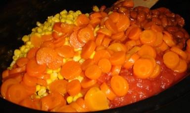 Add chili ingredients to the ground turkey, then stir to combine.