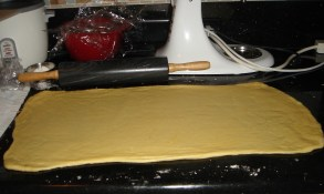 "Roll the dough into a 10×20-inch rectangle, about 1/4"" thick."