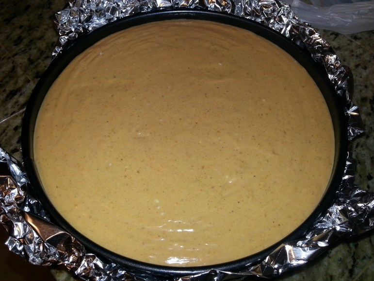 Bake the cheesecake at 350°F for 60 minutes, then leave it in the oven for another 60 minutes with the oven off.