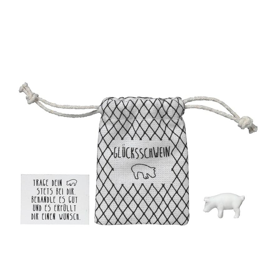 Schweinchen-Glücksbringer-mit-Säckchen-aus-Baumwolle