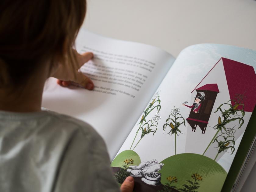 Kinderbuch Asagan_Mädchen lesend