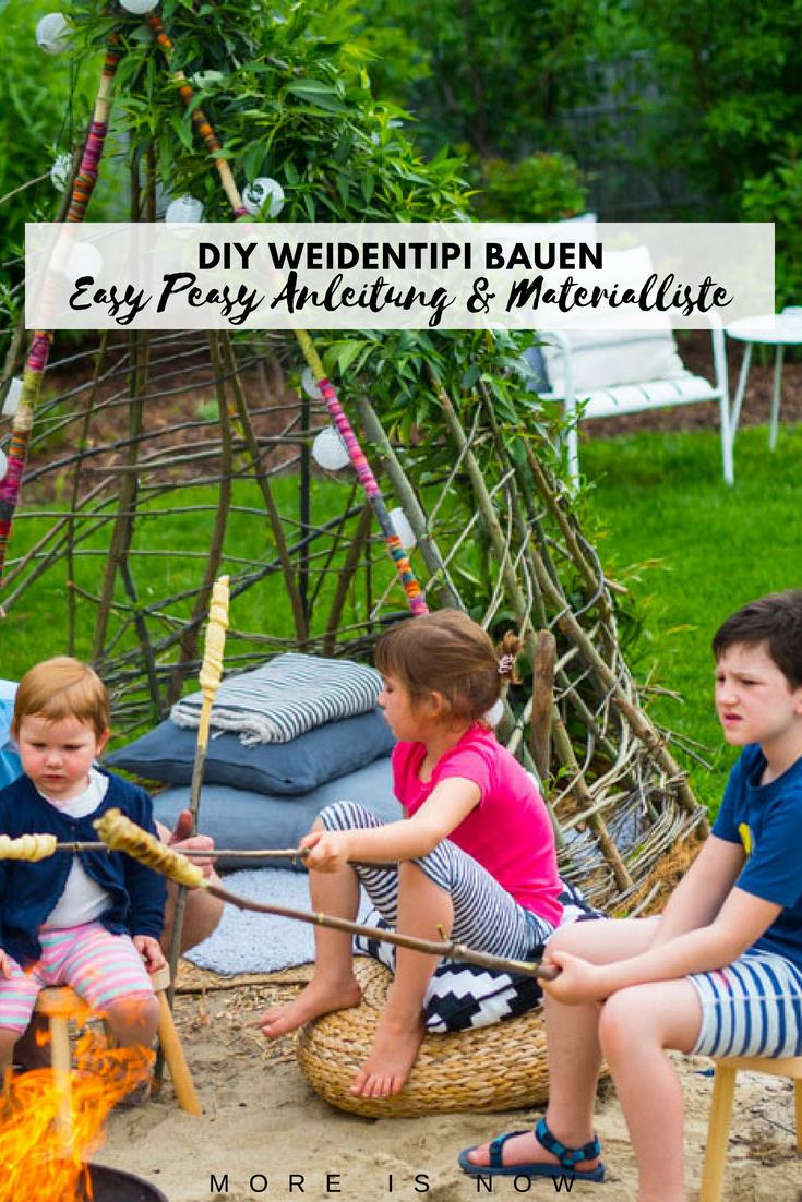 Weidentipi bauen mit Kindern_Kinder sitzen am Lagerfeuer