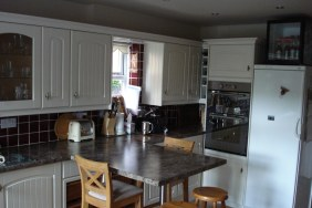 kitchen with breakfast bar and wooden fixtures