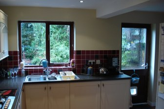 kitchen with red wall tiles