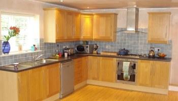 wooden kitchen with spotlights