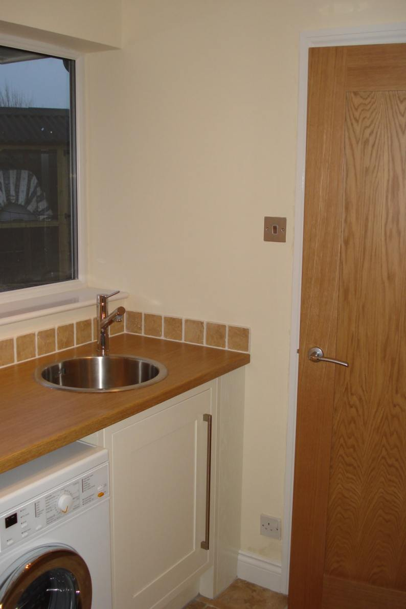 kitchen with sink and washing machine