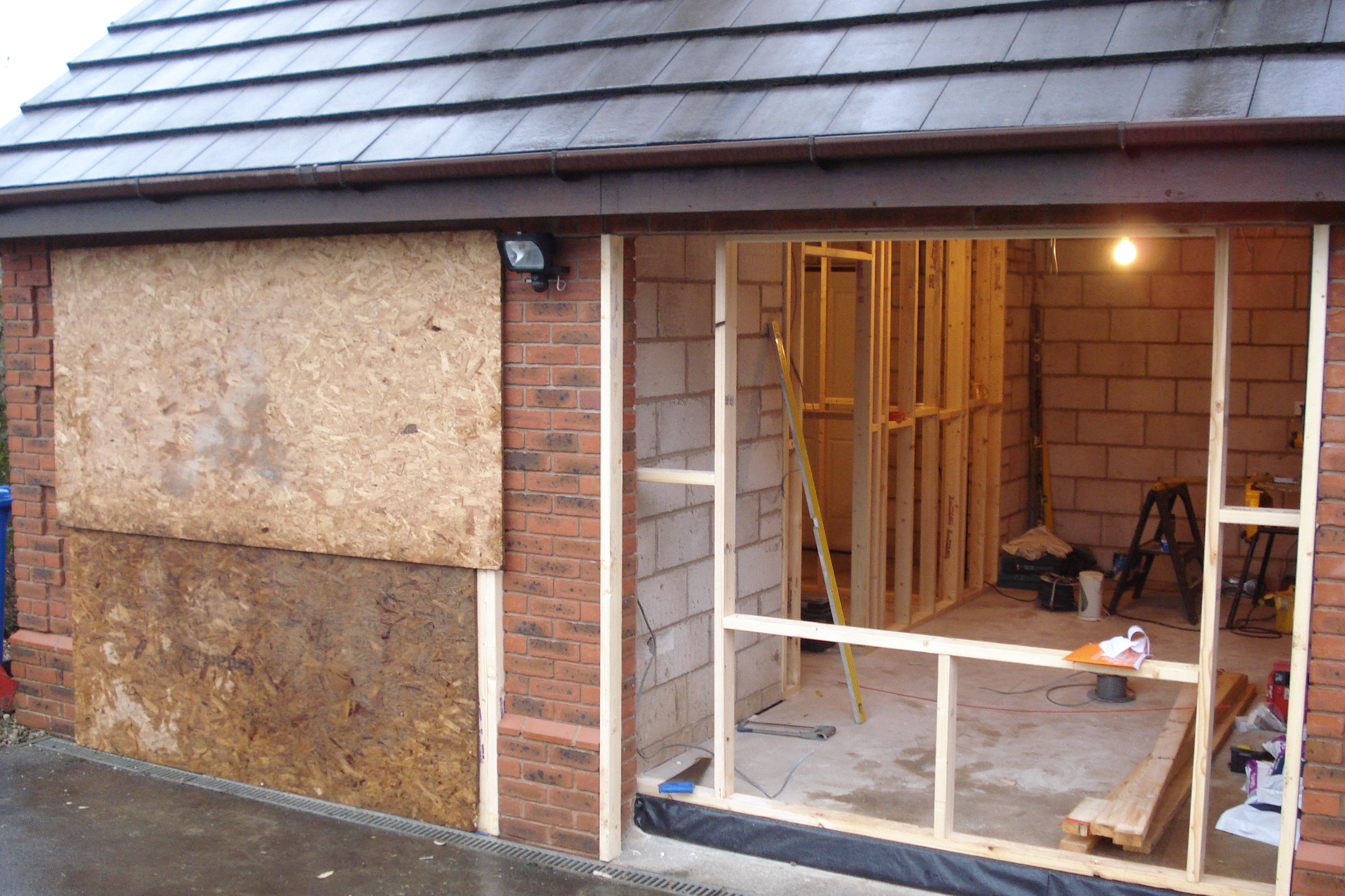 removal of garage doors prior to installation of windows and brickwork