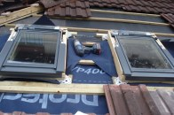 two velux windows being fitted