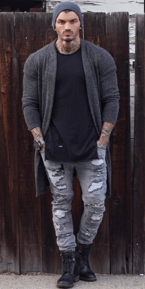 Devin Physique wearing a dark gray cardigan