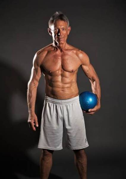 older bodybuilder on SARMs holding a medicine ball
