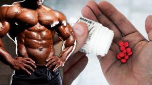 Bodybuilder with oral steroid pills on hands