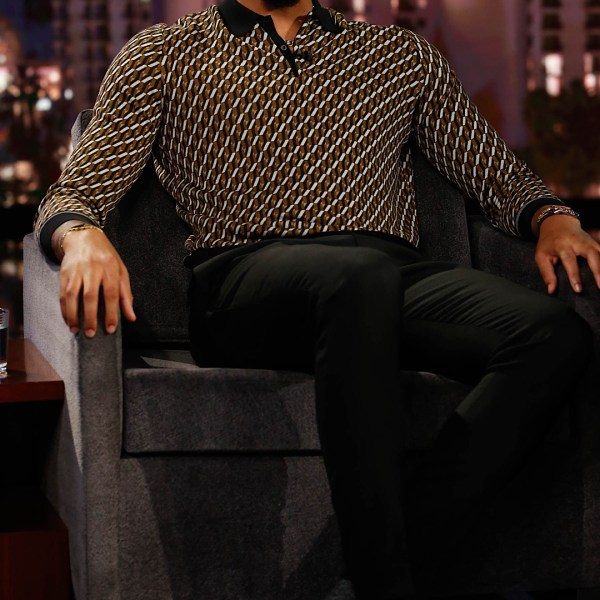 Anthony Davis Jimmy Kimmel Live! Prada Geometric Jacquard Polo And Travis Scott x Air Jordan 1 Low Sneakers.