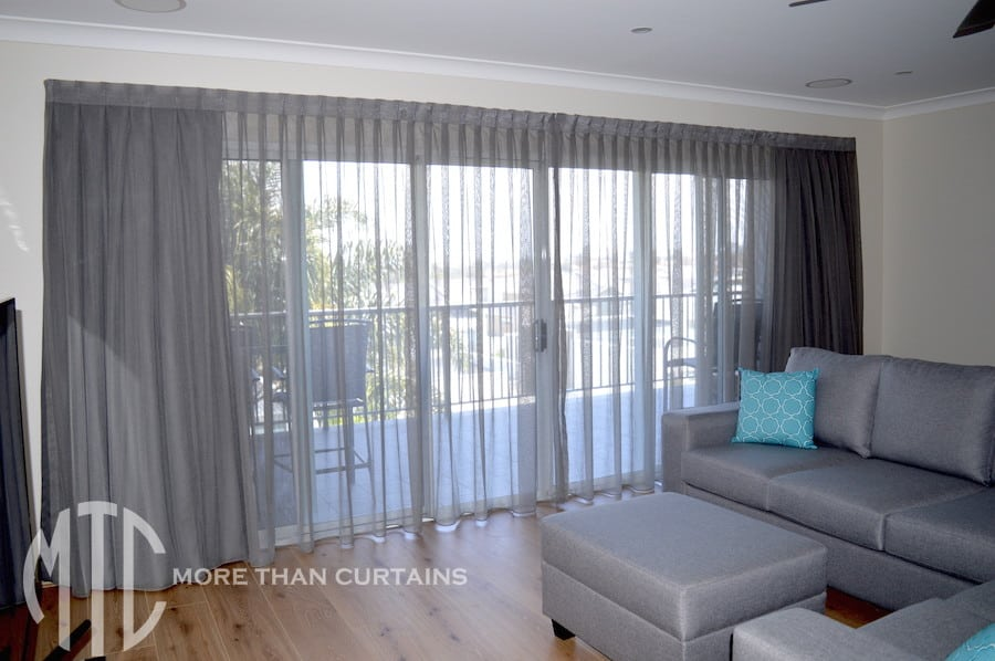 sheer curtains go in front or behind