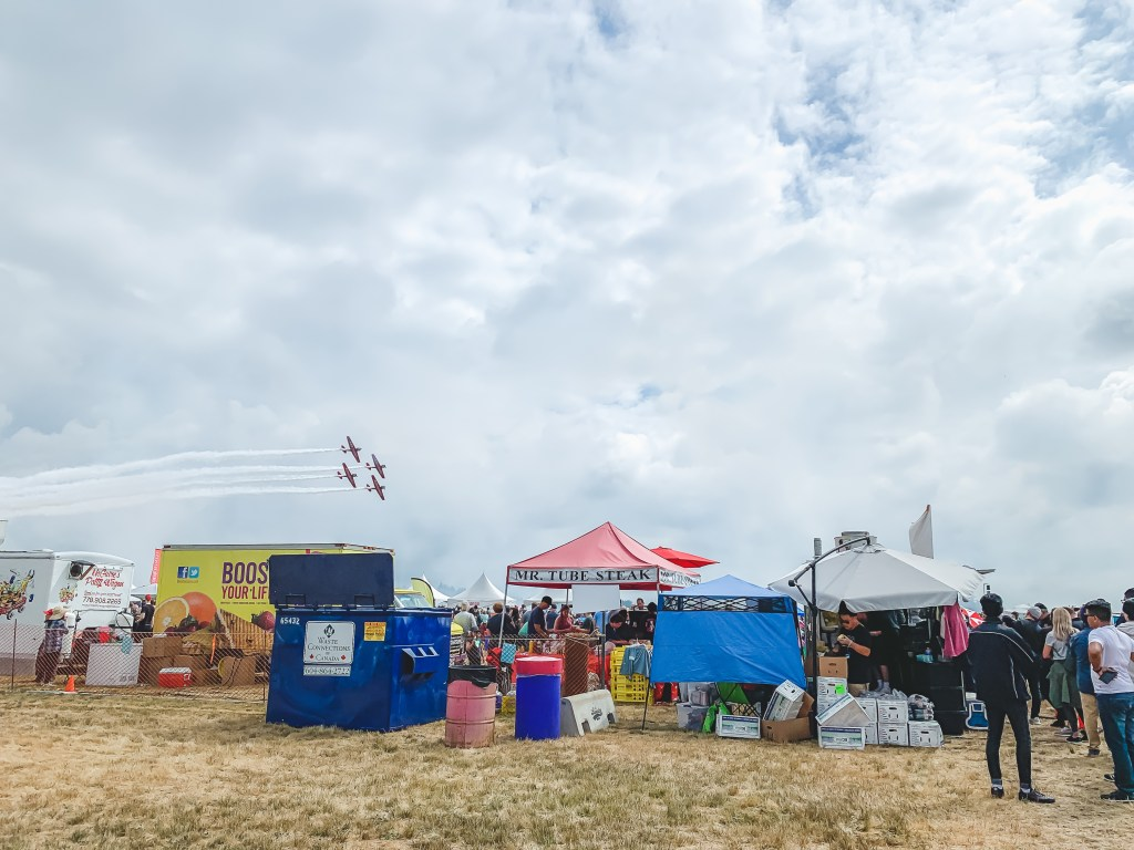 Stunt planes flying over food trucks at the 2019 Abbotsford Airshow
