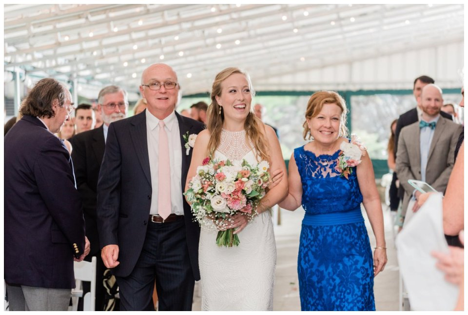 Warren Conference wedding bride walking down the aisle with parents father and mother
