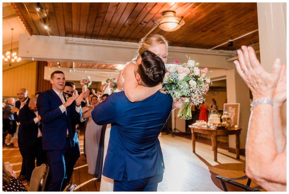 Warren Conference wedding groom lifting bride off her feet hugging embracing