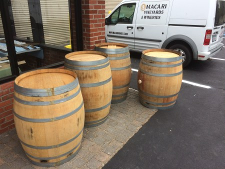 Empty wine barrels for use as tables in the brewery