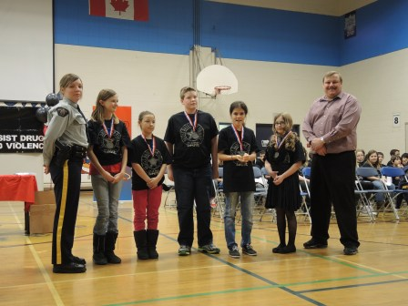 Primeau held their Grade 6 Drug Abuse Resistance Education (DARE) graduation Friday. RCMP Constable Yelena Avoine and Principal Allan Menduk presented certificates to students. DARE medal recipients included from left: Alyssa Lincez, Shyanne Boon, Logan House, Alexa Babin and Gracie Strong. - Lucie Roy Photo