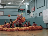 McNally High School Dragon Dancers enter- tained students, staff and parents at a reading assembly held at Morinville Public Elementary School Thursday. Classes and students who made amazing accomplishments in home reading minutes were recognized. Students have read 84,000 minutes since December. The goal is 500,000 minutes and they have 426,000 minutes of reading to reach their goal with four months of school left. The 400 students only need to read nine minutes per day to reach the half million minute goal.