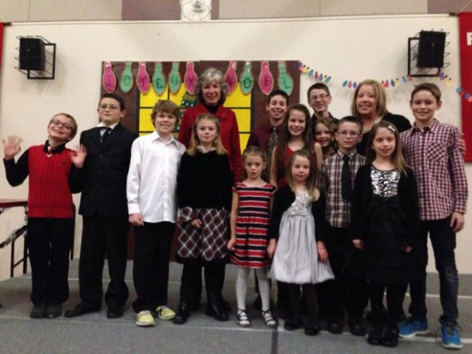 Minister of Culture and Tourism, the Honourable Maureen Kubinec poses with École Citadelle Principal Lisa Magera and students after the school's Christmas concert Dec. 11.