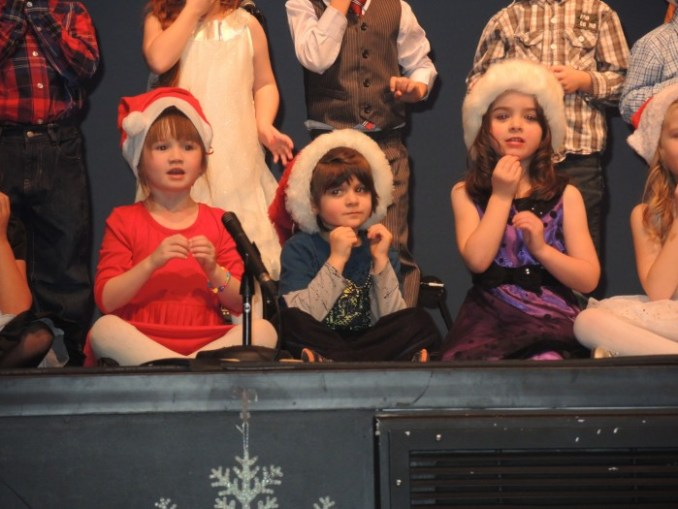 Morinville Public School Kindergarten students Mackenzie Jackson, Enver Hibbs-Pinney and Jaelyn Carson perform It Must be Santa at the 4th Annual MPS Snowflake Festival held Dec. 9.