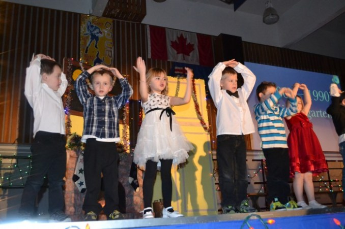 Legal sings Legal School celebrated Christmas Thoughout the Ages during their Christmas concert Dec. 11.  To coincide with the Greater St. Albert Catholic School Division 150th Anniversary, the students sang, danced, and performed various holiday hits.  Above: Kindergarten students sing And So This Is Christmas.   - Submitted Photo