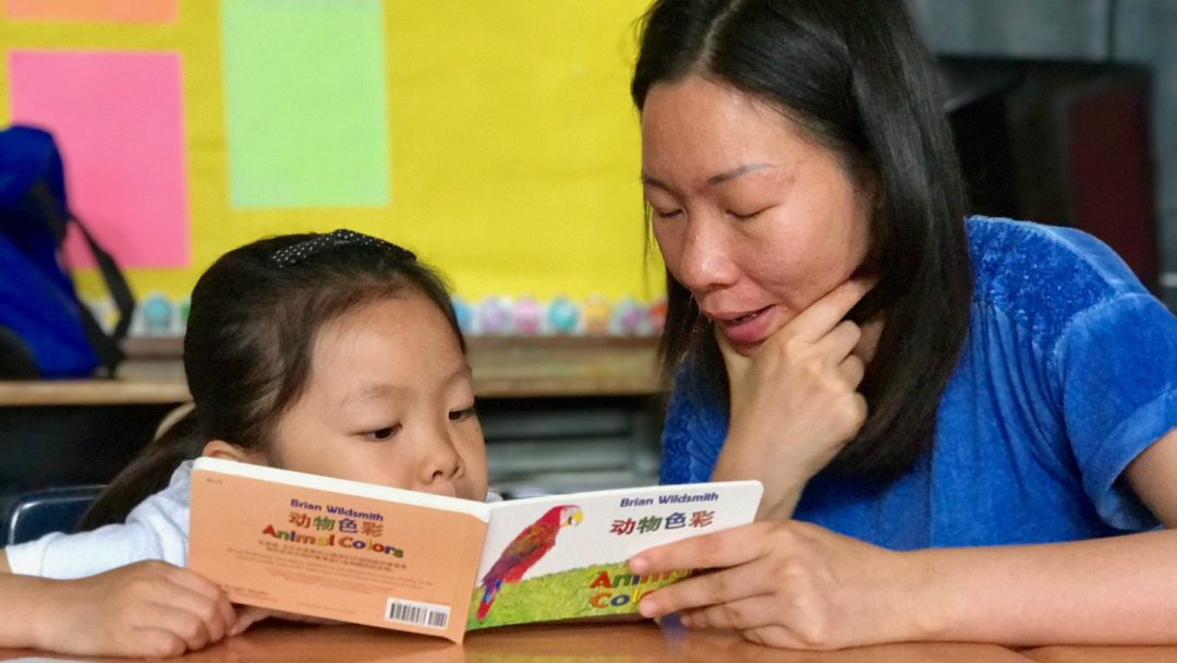 Parent reading to their child in class