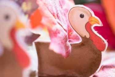 Close up of a cake topper shaped like a turkey.