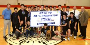 Bronx Science's Boys Badminton team posing with their 2018–19 championship banner and trophy.