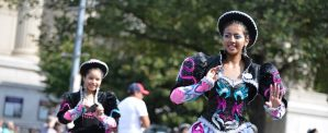 Two young Hispanic women dressed in traditional costume for Hispanic Heritage parade