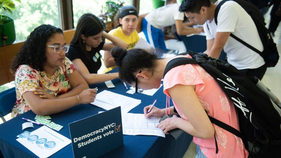 Students registering to vote during a student voter registration event in NYC