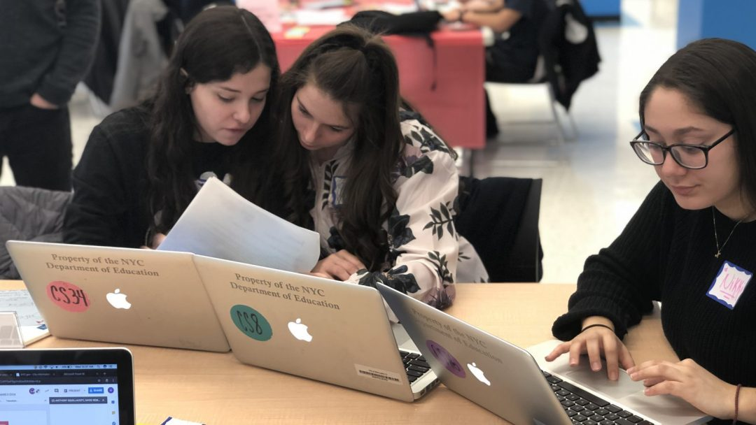 Female high school students working on some coding