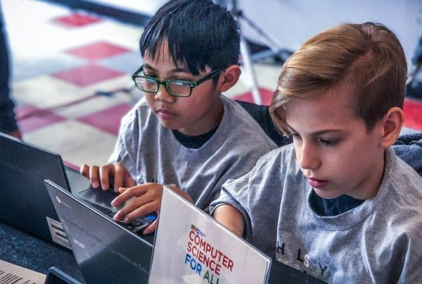 Two computer science students working on an Hour of Code