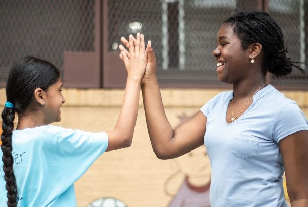 Two students high-fiving