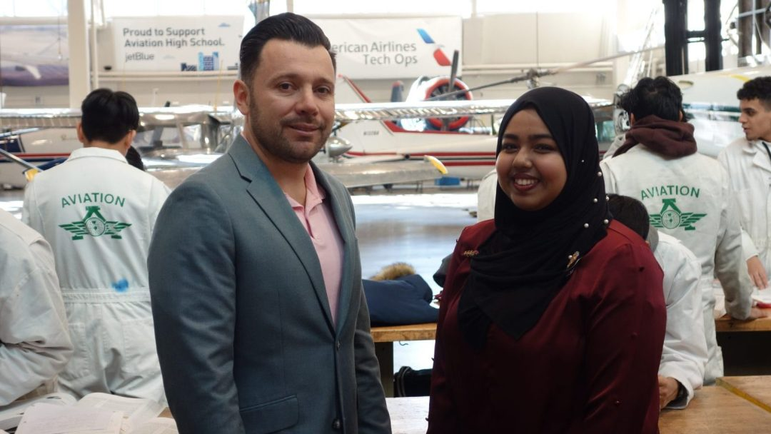 Sadia Ahmed (right) standing alongside an Aviation H.S. faculty member
