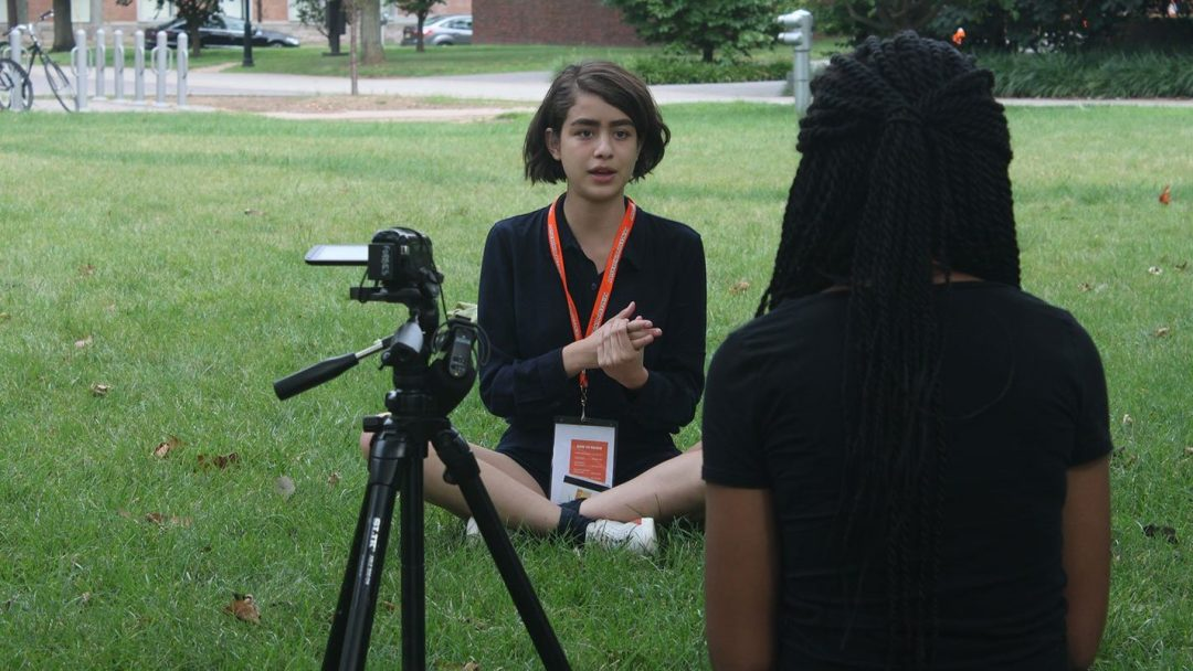 Journalism student interviewing another student