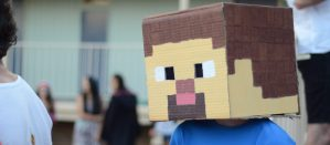 Kid wearing Minecraft character mask