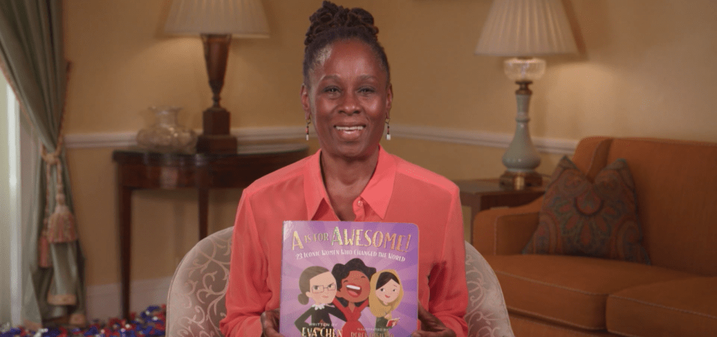 "First Lady Chirlane McCray holding up the book, ""A is for Awesome"""