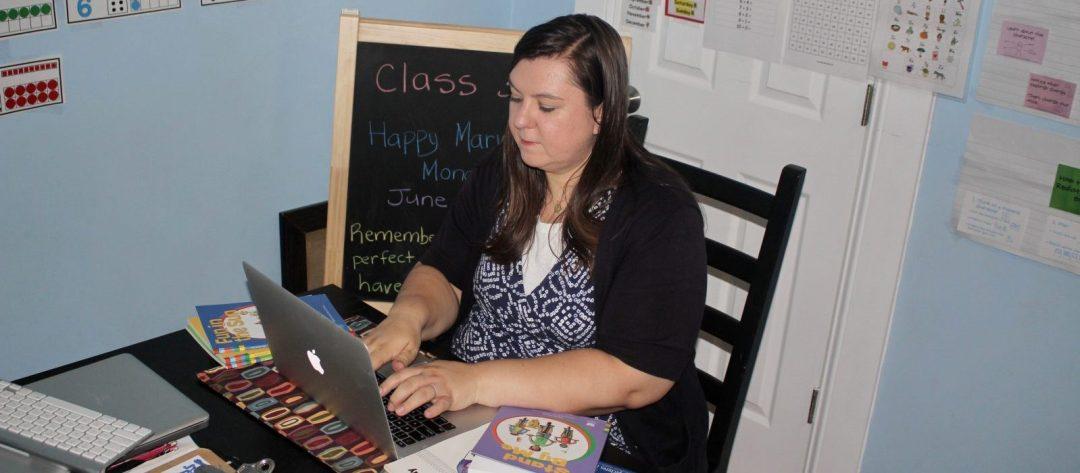 Teacher typing on her laptop