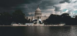 US Capitol Building Near Body of Water Under Cloudy Sky